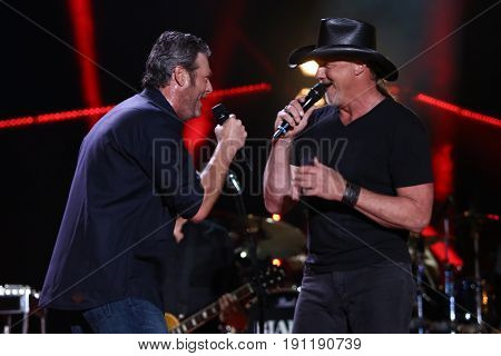 NASHVILLE, TN-JUN 9: Country singers Blake Shelton (L) and Trace Adkins perform in concert during the 2017 CMA Music Festival on June 9, 2017 at Nissan Stadium in Nashville, Tennessee.
