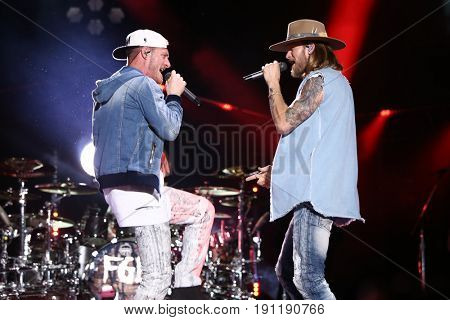 NASHVILLE, TN-JUN 9: Country singers Tyler Hubbard (L) and Brian Kelley of Florida Georgia Line perform during the 2017 CMA Music Festival on June 9, 2017 at Nissan Stadium in Nashville, Tennessee.