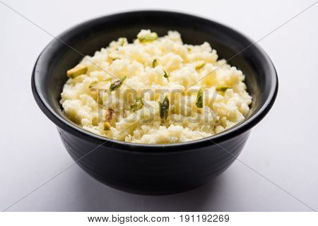 Kalakand is an Indian sweet made out of solidified, sweetened milk and paneer. The dish originated in Alwar, Rajasthan, India. Fresh raw kalakand served in bowl, selective focus