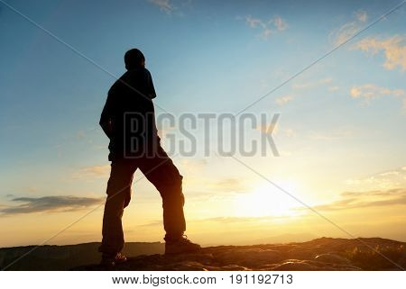 Man on top of mountain. Conceptual scene.