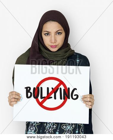 Middle eastern girl with stop bullying campaign poster
