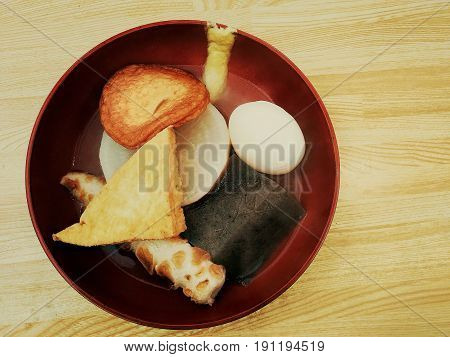 Oden with hot soup on wooden table, Japanese food.