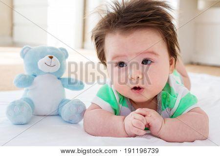 Happy Baby Boy With Teddy Bear