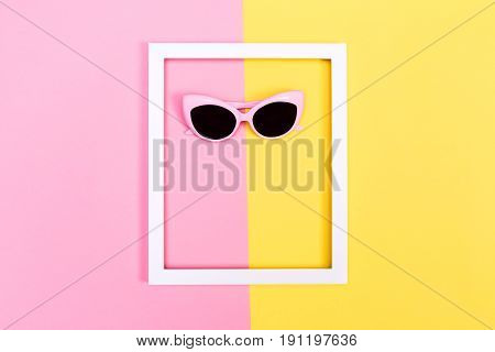 Sunglasses And Frame On Split Background