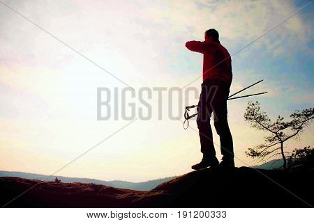 Alone Adult Man Backpacker At Sunrise At Open View On Mountain Peak