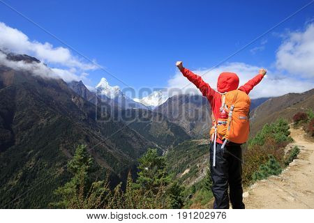 Woman backpacker trekking at the himalaya mountains