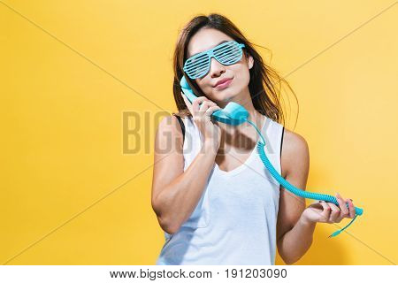 Young Woman Talking On Old Fashion Phone
