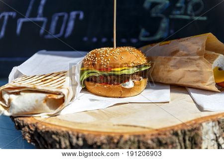 Burgers at a stand in a cafe at a street food festival