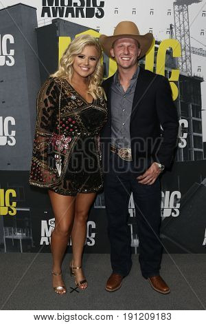 NASHVILLE, TN-JUN 07: Bull rider Cooper Davis (R) and Kaitlyn Davis attend the 2017 CMT Music Awards at the Music City Center on June 7, 2017 in Nashville, Tennessee.