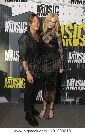 NASHVILLE, TN-JUN 07: Keith Urban (L) and Nicole Kidman attend the 2017 CMT Music Awards at the Music City Center on June 7, 2017 in Nashville, Tennessee.