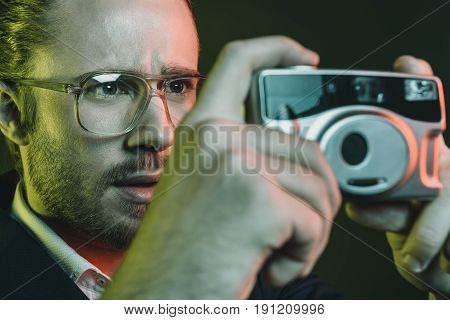 Young Caucasian Man Taking Photo On Compact Camera