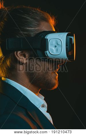 Profile Of Young Man Using Virtual Reality Headset