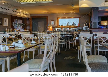 Taupo , New Zealand - April 14 2017 : Continental breakfast is arranged for hotel 's guests in the restaurant viewing the beauty of Lake Taupo in the morning