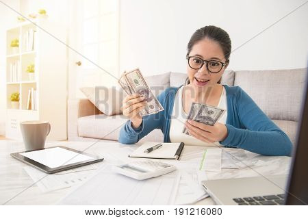 Student Counting Her Scholarship Money