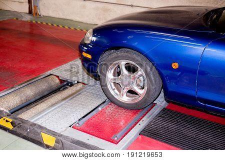 Shock Absorber Test Rolls In A Garage