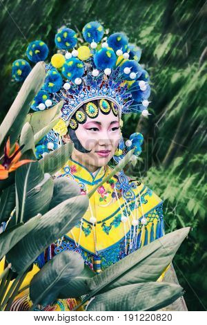 Portrait Of Pretty Asian Woman In Traditional Chinese Yellow And Blue Costume And Hat With Pompons S