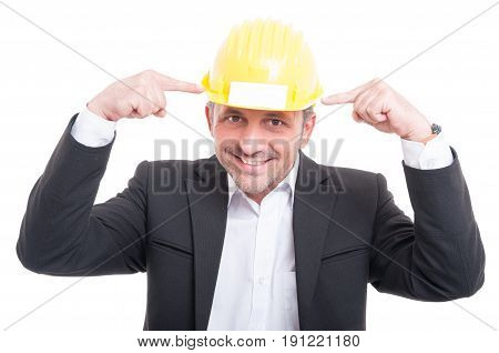 Portrait Of Foreman Pointing Hardhat With Business Card