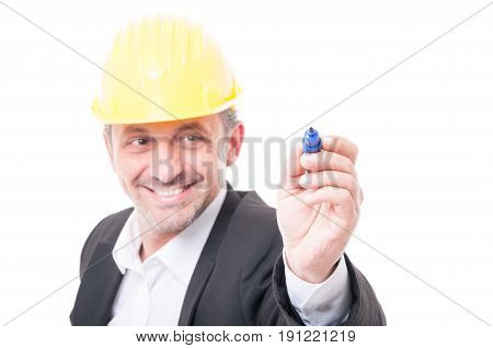 Selective Focus Of Contractor Wearing Hardhat Writing With Marker