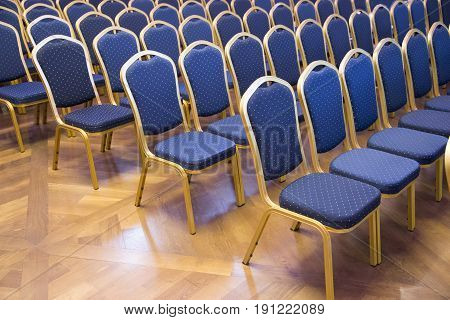 Empty blue colored auditorium seats in unknown business hall