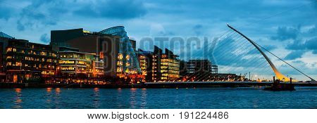 Dublin Ireland. Samuel Becket Bridge at sunset in Dublin Ireland. Beautiful architecture and illuminated modern hotels