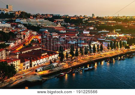 Porto Portugal. Aerial view of wine yards at night in the city of Gaia Portugal. It is famous for Port Wine cellars and nightlife