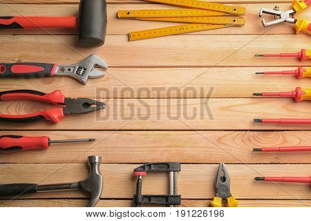 Set of carpenter's tools with place for text on wooden table