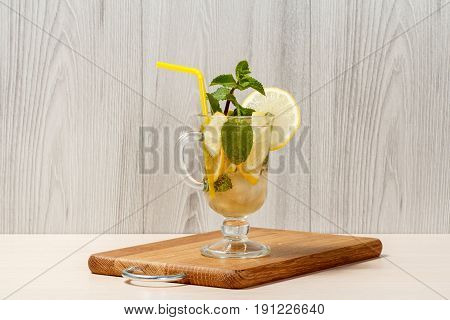 Carbonated Lemonade With Lemon Slices And Mint On An Wooden Cutting Board