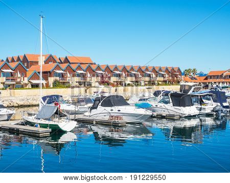 HILLARYS ,AUSTRALIA - MAY 25, 2017: Boats moored at Hillarys Boat Harbour, a marina and tourist precinct located in Hillarys, north of Perth in Western Australia.