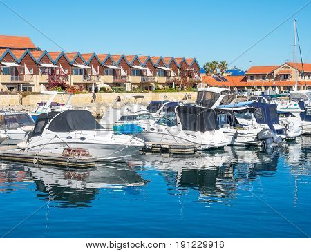 HILLARYS, AUSTRALIA - MAY 25, 2017: Boats moored at Hillarys Boat Harbour, a marina and tourist precinct located in Hillarys, north of Perth in Western Australia.
