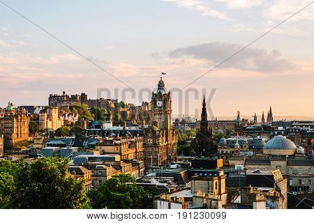Edinburgh UK. Aerial view from Calton Hill in Edinburgh Scotland. The city with Castle and Clock Tower during the evening. Cloudy sunset sky