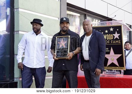 LOS ANGELES - JUN 12:  William Loshawn Calhoun Jr aka WC, Ice Cube, John Singleton at the Ice Cube Star Ceremony on the Hollywood Walk of Fame on June 12, 2017 in Los Angeles, CA