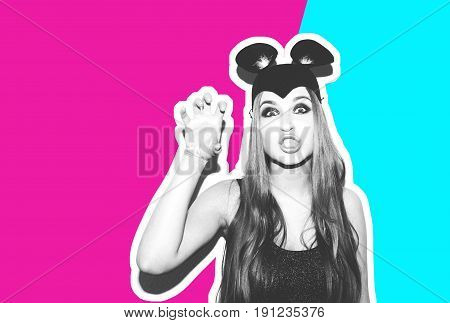 Funny girl represents small cat or mouse. Woman with bright makeup hairstyle and night dress mouse ears having fun. On white background not isolated