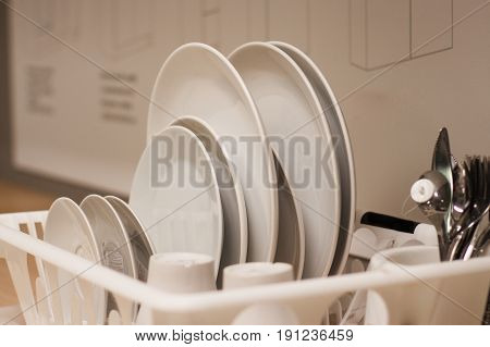 a stack of white dishes and soup bowls isolated.