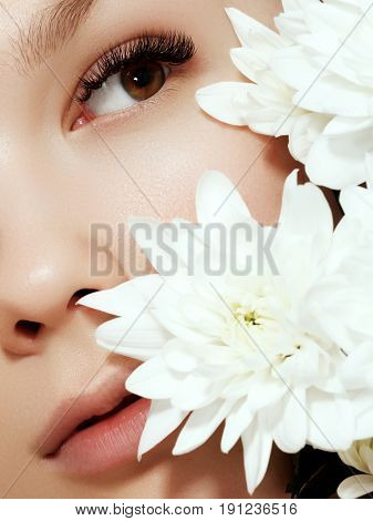 Beautiful Girl With Flowers.beauty Model Woman Face. Perfect Skin. Professional Make-up.makeup. Fash