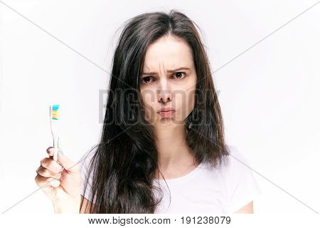 Teeth care, woman holding a toothbrush, toothbrush, healthy teeth, a woman rinses her mouth on an isolated background.
