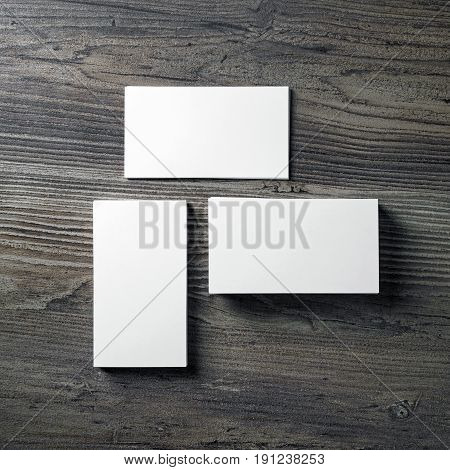 Photo of blank business cards on wooden table background. Mock-up for ID. Template for branding identity with plenty of copy space. Top view.