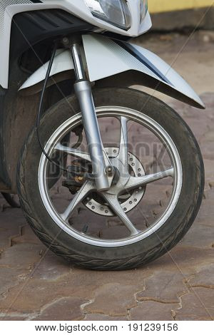 Front wheel of the gray colored motorcycle
