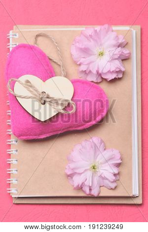 Heart In Pink Colour With Sakura Flowers On Beige Diary