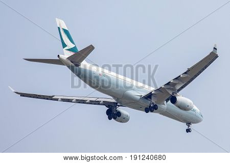 Bangkok, Thailand. - April 23, 2017 : Plane or aircraft of Cathy Pacific Airlines or Airways on the sky landing to Suvanabhumi airport.
