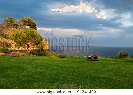Lawn with deck chairs and views of the sea