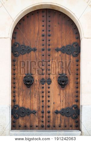 Old wooden door in a house made of marbel
