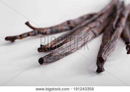 Dried vanilla sticks on white background, closeup