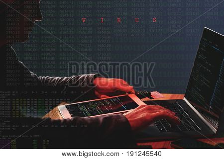 Unrecognizable internet criminal attacking database firewall on laptop with computer virus