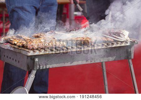 Chef bbq grilled pork ribs on smoke