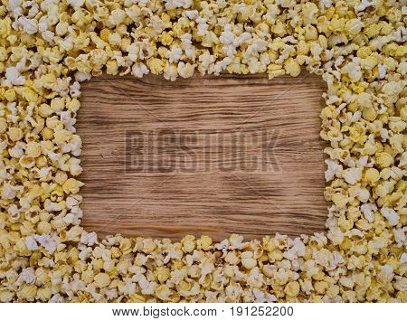 popcorn on an old table under a prompt