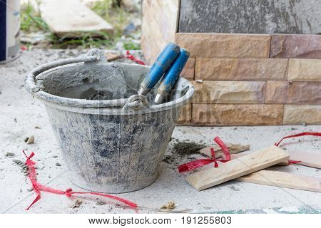 building construction men work cut tile sandstone buil on wall