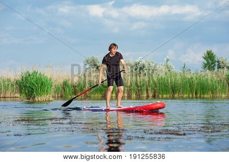 Sup Stand Up Man With A Paddle 06
