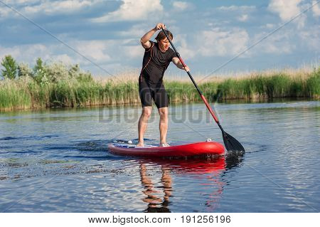 Sup Stand Up Man With A Paddle 05