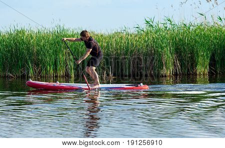 Sup Stand Up Man With A Paddle 04
