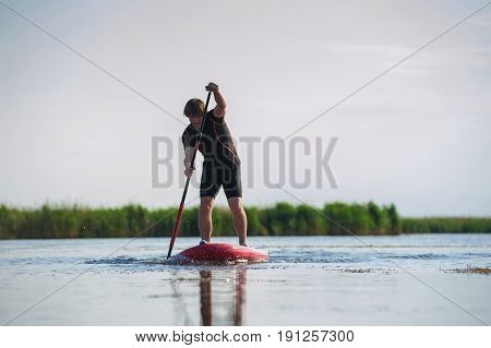 Sup Stand Up Man With A Paddle 02